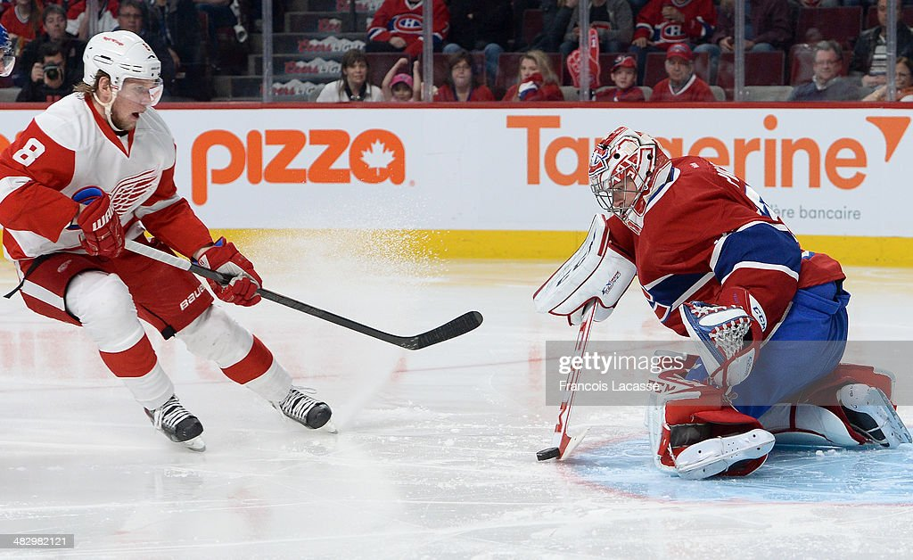 <a gi-track='captionPersonalityLinkClicked' href=/galleries/search?phrase=Carey+Price&family=editorial&specificpeople=2222083 ng-click='$event.stopPropagation()'>Carey Price</a> #31 of the Montreal Canadiens blocks the shot by <a gi-track='captionPersonalityLinkClicked' href=/galleries/search?phrase=Justin+Abdelkader&family=editorial&specificpeople=2271858 ng-click='$event.stopPropagation()'>Justin Abdelkader</a> #8 of the Detroit Red Wings during the NHL game on April 5, 2014 at the Bell Centre in Montreal, Quebec, Canada.
