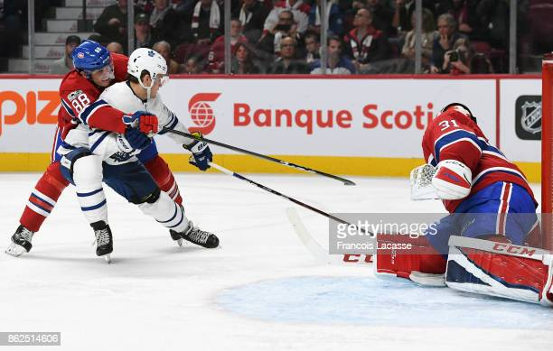 Carey Price of the Montreal Canadiens blocks the shot William Nylander of the Toronto Maple Leafs in the NHL game at the Bell Centre on October 14...