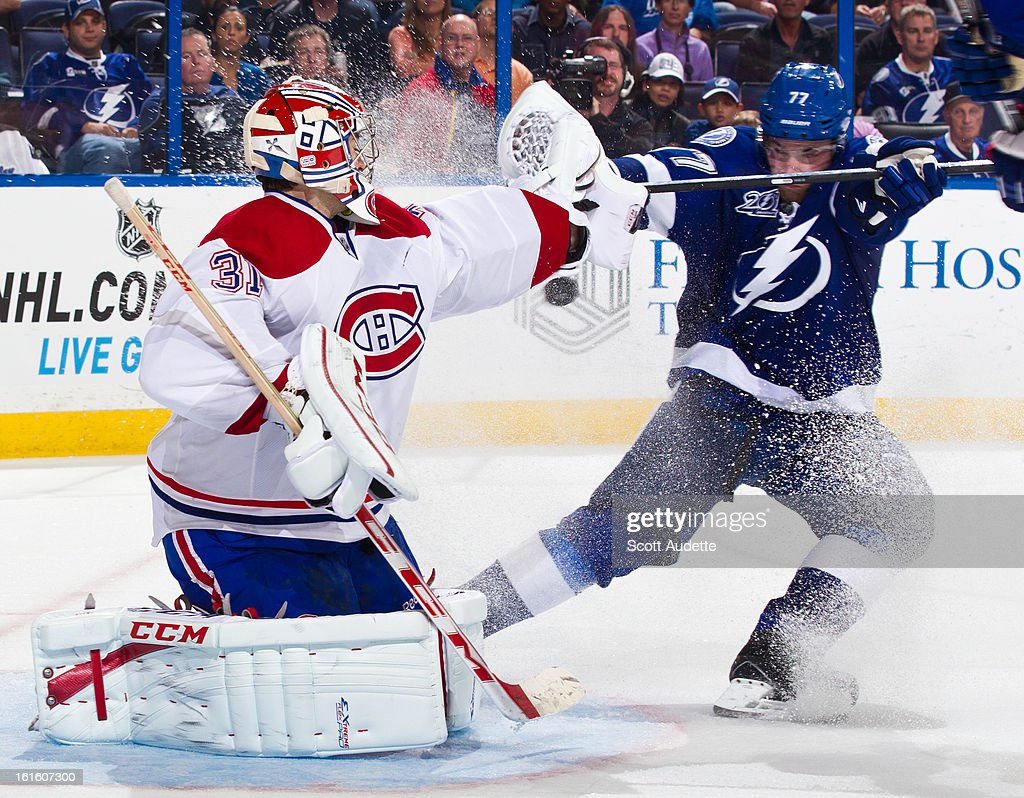 <a gi-track='captionPersonalityLinkClicked' href=/galleries/search?phrase=Carey+Price&family=editorial&specificpeople=2222083 ng-click='$event.stopPropagation()'>Carey Price</a> #31 of the Montreal Canadiens blocks <a gi-track='captionPersonalityLinkClicked' href=/galleries/search?phrase=Victor+Hedman&family=editorial&specificpeople=4784238 ng-click='$event.stopPropagation()'>Victor Hedman</a> #77 of the Tampa Bay Lightning during the third period of the game at the Tampa Bay Times Forum on February 12, 2013 in Tampa, Florida.