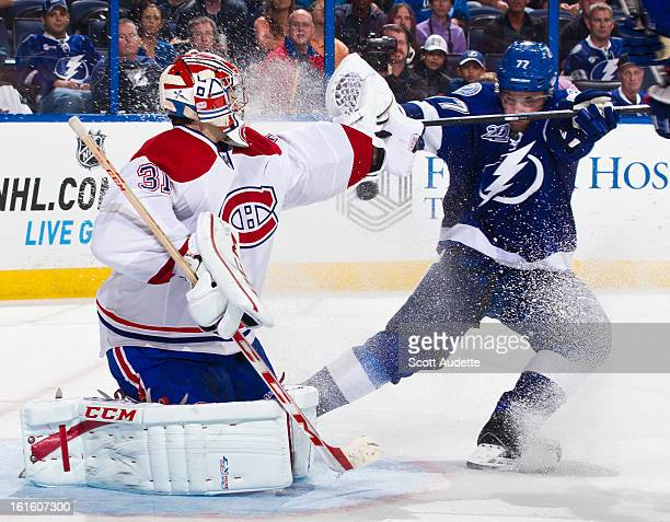 Carey Price of the Montreal Canadiens blocks Victor Hedman of the Tampa Bay Lightning during the third period of the game at the Tampa Bay Times...