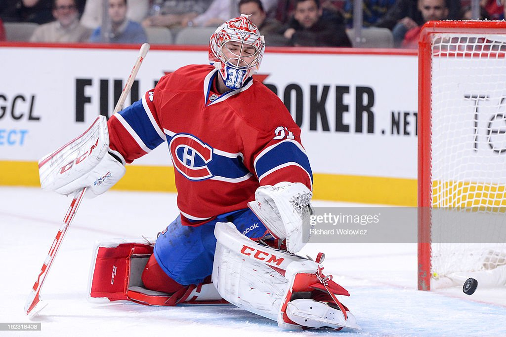 <a gi-track='captionPersonalityLinkClicked' href=/galleries/search?phrase=Carey+Price&family=editorial&specificpeople=2222083 ng-click='$event.stopPropagation()'>Carey Price</a> #31 of the Montreal Canadiens can't make the stop on a goal by Frans Nielsen (not pictured) of the New York Islanders during the NHL game at the Bell Centre on February 21, 2013 in Montreal, Quebec, Canada. The Islanders defeated the Canadiens 4-3 in overtime.