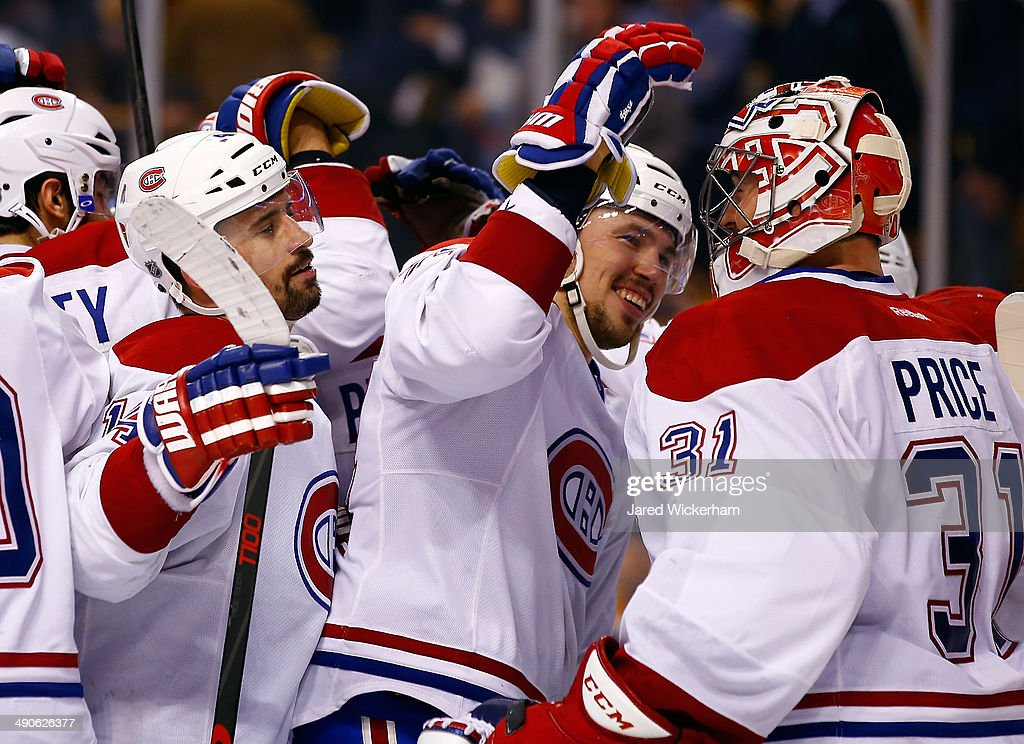 Carey Price #31 of the Montreal Canadiens celebrates with teammates after defeating the Boston Bruins 3-1 in Game Seven of the Second Round of the 2014 NHL Stanley Cup Playoffs at the TD Garden on May 14, 2014 in Boston, Massachusetts.