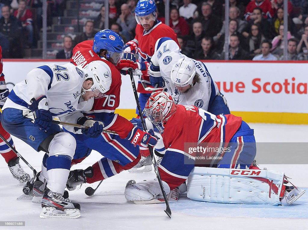 <a gi-track='captionPersonalityLinkClicked' href=/galleries/search?phrase=Carey+Price&family=editorial&specificpeople=2222083 ng-click='$event.stopPropagation()'>Carey Price</a> #31 of the Montreal Canadiens covers the puck with his glove as <a gi-track='captionPersonalityLinkClicked' href=/galleries/search?phrase=Dana+Tyrell&family=editorial&specificpeople=2129723 ng-click='$event.stopPropagation()'>Dana Tyrell</a> #42 of the Tampa Bay Lightning battles for position against <a gi-track='captionPersonalityLinkClicked' href=/galleries/search?phrase=P.K.+Subban&family=editorial&specificpeople=714418 ng-click='$event.stopPropagation()'>P.K. Subban</a> #76 of the Canadiens during NHL action on April 18, 2013 at the Bell Centre in Montreal, Quebec, Canada.