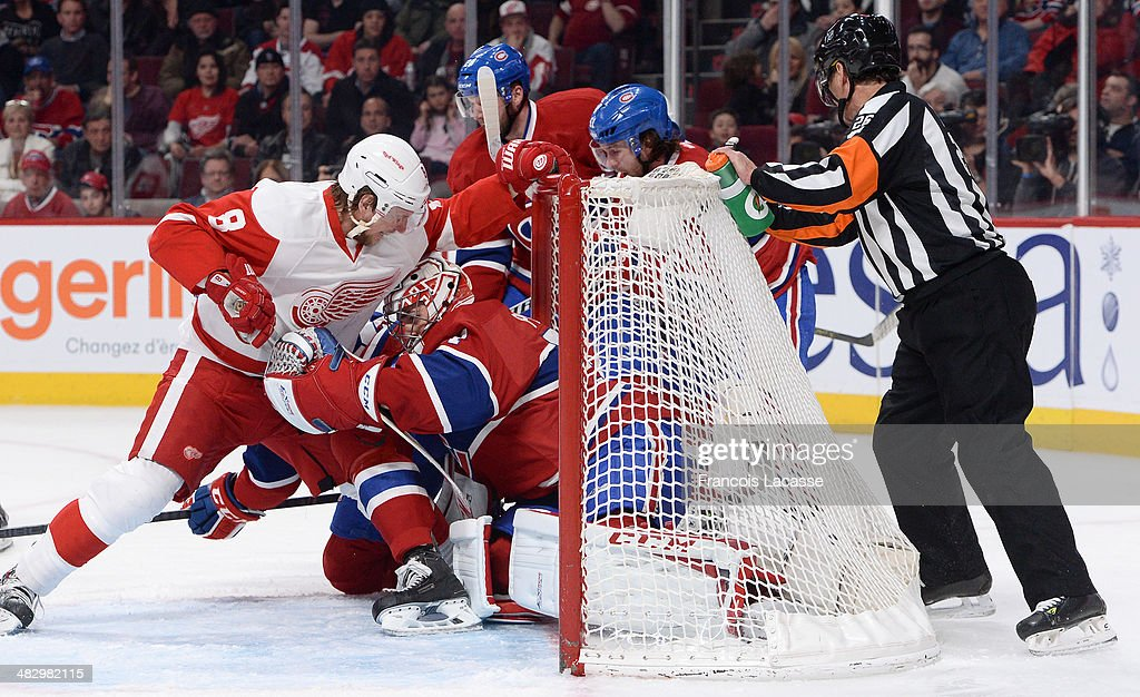 <a gi-track='captionPersonalityLinkClicked' href=/galleries/search?phrase=Carey+Price&family=editorial&specificpeople=2222083 ng-click='$event.stopPropagation()'>Carey Price</a> #31 of the Montreal Canadiens defends the goal against <a gi-track='captionPersonalityLinkClicked' href=/galleries/search?phrase=Justin+Abdelkader&family=editorial&specificpeople=2271858 ng-click='$event.stopPropagation()'>Justin Abdelkader</a> #8 of the Detroit Red Wings during the NHL game on April 5, 2014 at the Bell Centre in Montreal, Quebec, Canada.