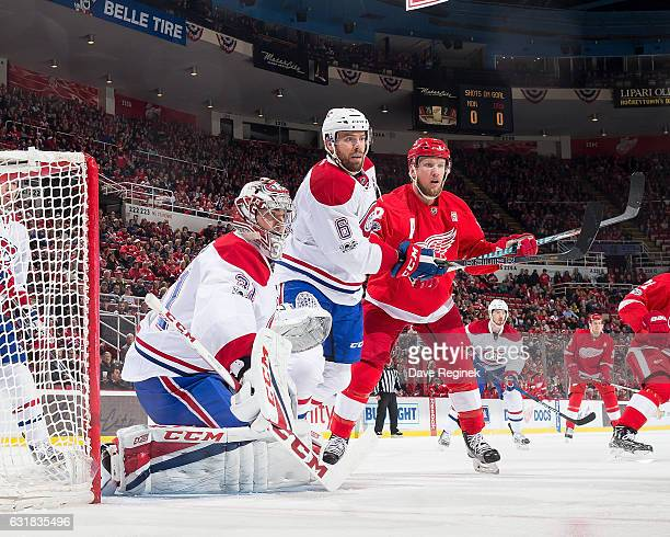 Carey Price of the Montreal Canadiens follows the play as teammate Shea Weber battles for position with Justin Abdelkader of the Detroit Red Wings...