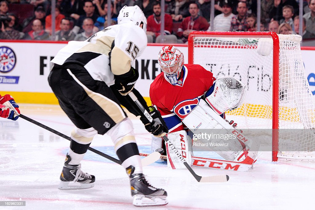 Carey Price #31 of the Montreal Canadiens gets down to stop the puck on an attempt by Dustin Jeffrey #15 of the Pittsburgh Penguins during the NHL game at the Bell Centre on March 2, 2013 in Montreal, Quebec, Canada. The Penguins defeated the Canadiens 7-6 in overtime.