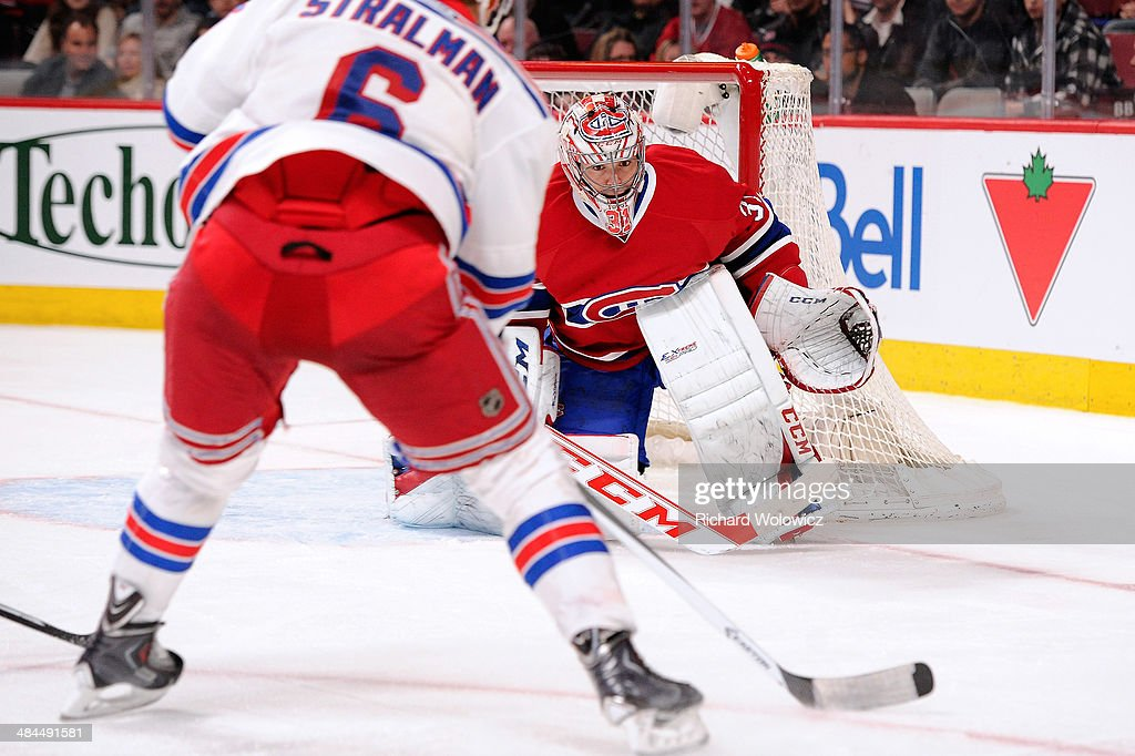 Carey Price #31 of the Montreal Canadiens gets down to stop the puck on an attempt by Anton Stralman #6 of the New York Rangers during the NHL game at the Bell Centre on April 12, 2014 in Montreal, Quebec, Canada. The Canadiens defeated the Rangers 1-0 in overtime.
