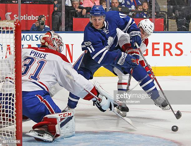 Carey Price of the Montreal Canadiens gets set to face a cutting Zach Hyman of the Toronto Maple Leafs during an NHL game at the Air Canada Centre on...