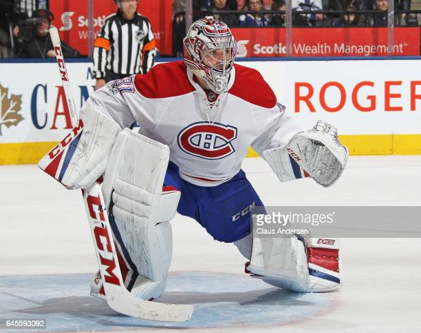 Carey Price of the Montreal Canadiens gets set to face a shot against the Toronto Maple Leafs during an NHL game at the Air Canada Centre on February...