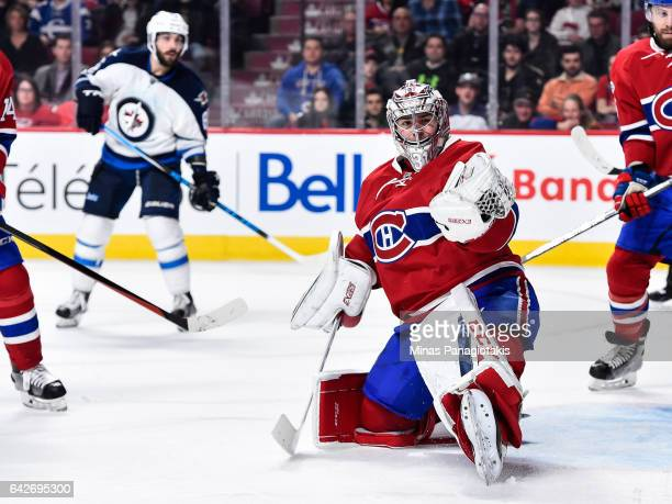 Carey Price of the Montreal Canadiens gloves the puck during the NHL game against the Winnipeg Jets at the Bell Centre on February 18 2017 in...