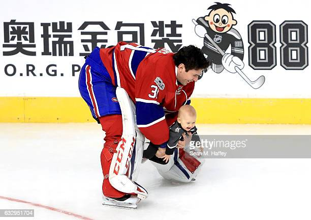 Carey Price of the Montreal Canadiens holds his daughter Liv Anniston in the DraftKings NHL Accuracy Shooting event during the 2017 Coors Light NHL...