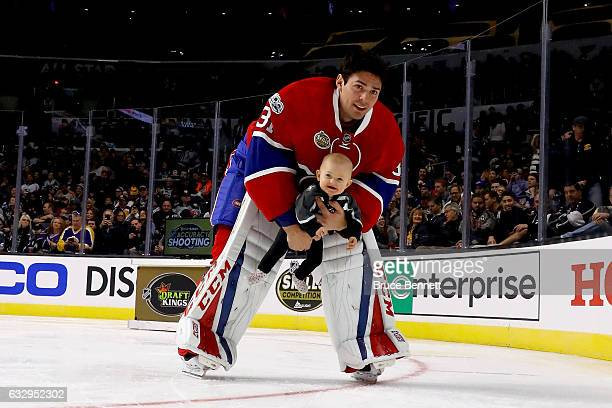 Carey Price of the Montreal Canadiens holds his daughter Liv Anniston in the Honda NHL Four Line Challenge during the 2017 Coors Light NHL AllStar...