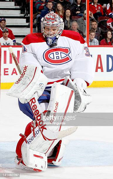 Carey Price of the Montreal Canadiens is hit under the chin by the puck from a shot by the Ottawa Senators at Scotiabank Place on March 16 2012 in...