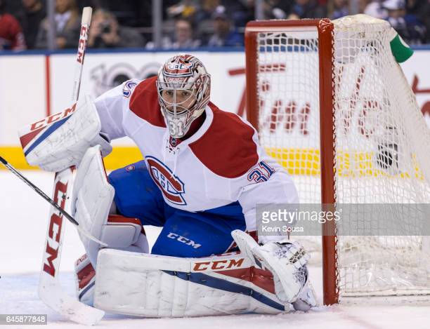 Carey Price of the Montreal Canadiens keeps his eyes on the puck against the Toronto Maple Leafs during the second period at the Air Canada Centre on...