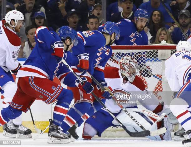 Carey Price of the Montreal Canadiens keeps his eyes on the puck during the first period against the New York Rangers in Game Three of the Eastern...
