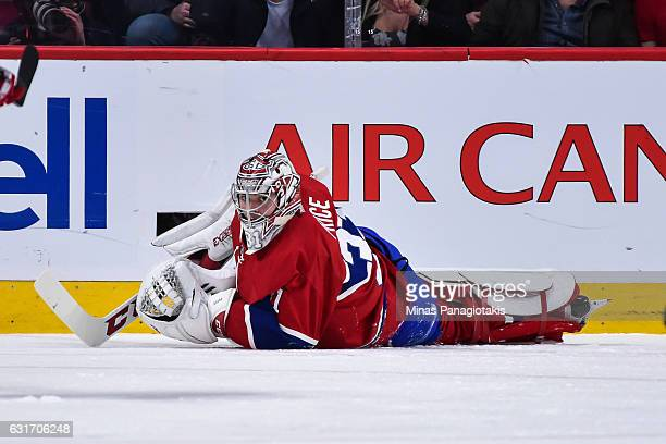 Carey Price of the Montreal Canadiens looks on as he lies on the ice after being dragged out of his net and allowing a goal in the second period...