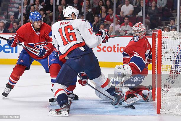 Carey Price of the Montreal Canadiens looks over his shoulder as the puck bounces in the net during the NHL game against the Washington Capitals on...
