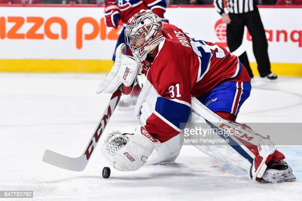 Carey Price of the Montreal Canadiens looks to cover the puck during the NHL game against the Nashville Predators at the Bell Centre on March 2 2017...