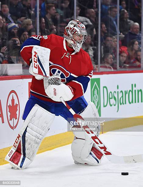 Carey Price of the Montreal Canadiens looks to pass the puck against the Calgary Flames in the NHL game at the Bell Centre on January 24 2017 in...