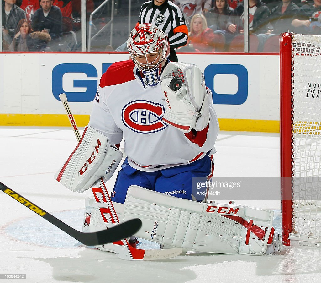 <a gi-track='captionPersonalityLinkClicked' href=/galleries/search?phrase=Carey+Price&family=editorial&specificpeople=2222083 ng-click='$event.stopPropagation()'>Carey Price</a> #31 of the Montreal Canadiens make a glove save against the New Jersey Devils during the game at the Prudential Center on March 16, 2013 in Newark, New Jersey.