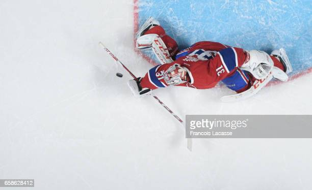 Carey Price of the Montreal Canadiens makes a blocker save on a shot by the Carolina Hurricanes in the NHL game at the Bell Centre on March 23 2017...
