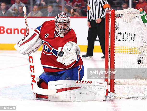 Carey Price of the Montreal Canadiens makes a glove save against the Philadelphia Flyers in the NHL game at the Bell Centre on February 10 2015 in...