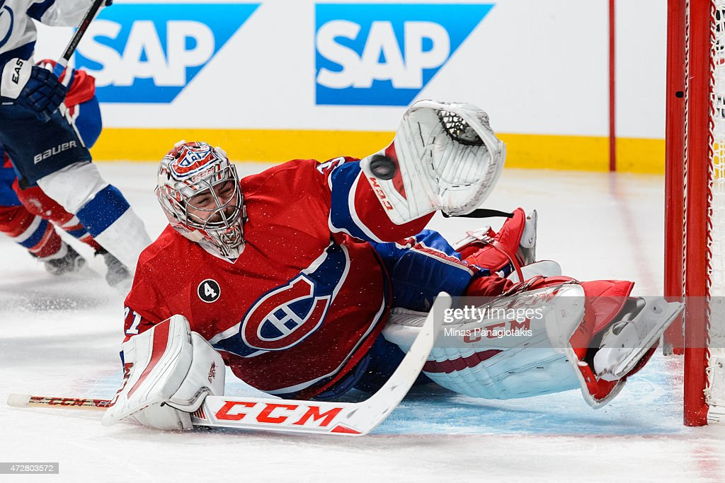Carey Price of the Montreal Canadiens makes a glove save in Game Five of the Eastern Conference Semifinals against the Tampa Bay Lightning during the...