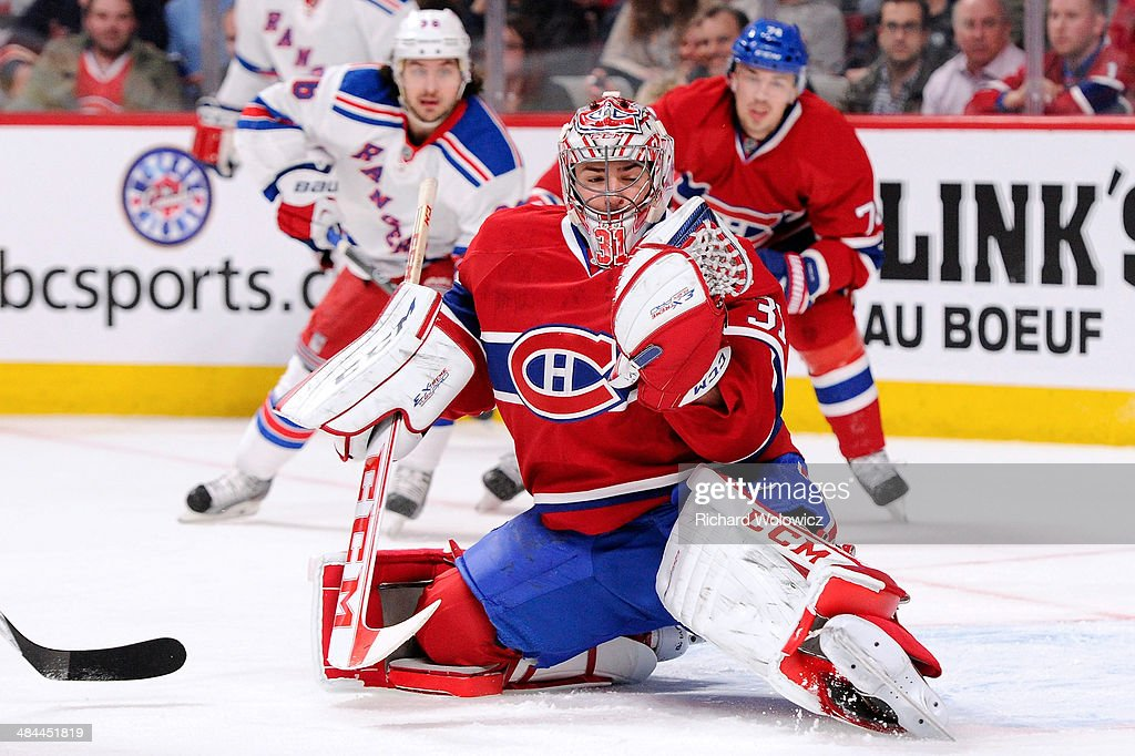 Carey Price #31 of the Montreal Canadiens makes a glove save on the puck during the NHL game against the New York Rangers at the Bell Centre on April 12, 2014 in Montreal, Quebec, Canada.