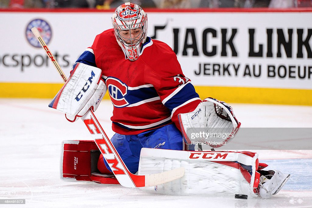 Carey Price #31 of the Montreal Canadiens makes a pad save on the puck during the NHL game against the New York Rangers at the Bell Centre on April 12, 2014 in Montreal, Quebec, Canada. The Canadiens defeated the Rangers 1-0 in overtime.