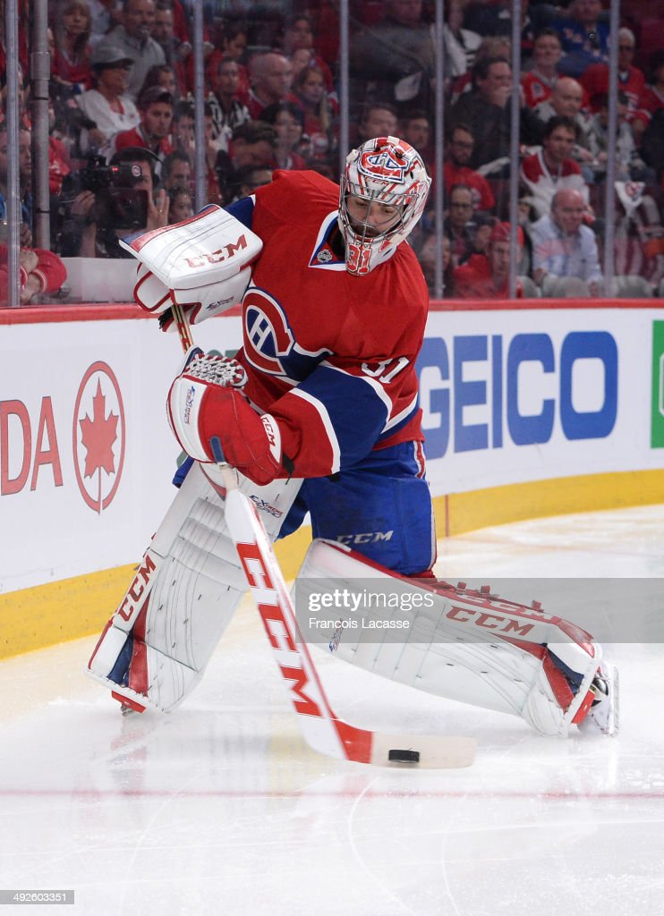 Carey Price #31 of the Montreal Canadiens makes a pass during the game against the New York Rangers in Game One of the Eastern Conference Final during the 2014 Stanley Cup Playoffs at the Bell Centre on May 17, 2014 in Montreal, Quebec, Canada.