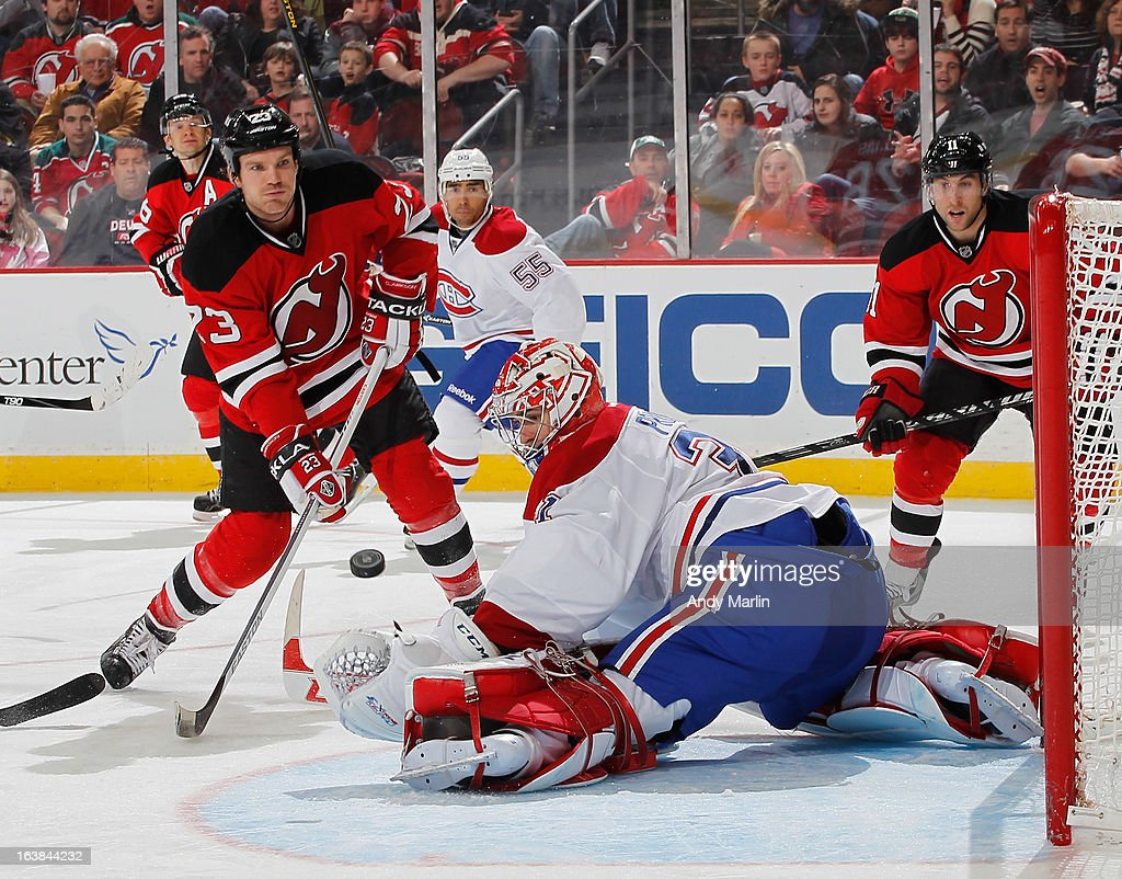 <a gi-track='captionPersonalityLinkClicked' href=/galleries/search?phrase=Carey+Price&family=editorial&specificpeople=2222083 ng-click='$event.stopPropagation()'>Carey Price</a> #31 of the Montreal Canadiens makes a save against David Clarkson #23 of the New Jersey Devils during the game at the Prudential Center on March 16, 2013 in Newark, New Jersey.