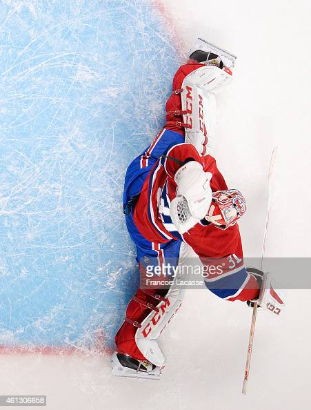 Carey Price of the Montreal Canadiens makes a save against the Pittsburgh Penguins in the NHL game at the Bell Centre on January 10 2015 in Montreal...