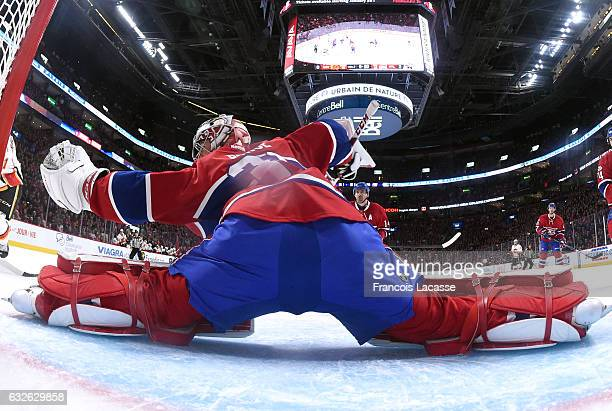 Carey Price of the Montreal Canadiens makes a save against the Calgary Flames in the NHL game at the Bell Centre on January 24 2017 in Montreal...