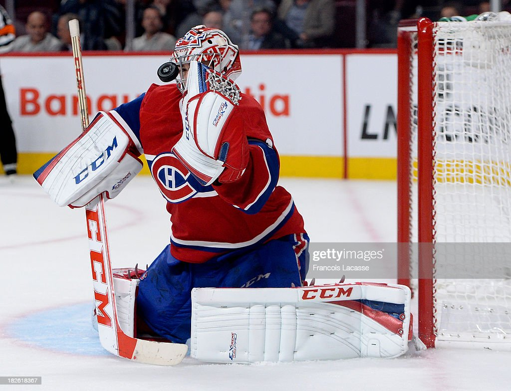 <a gi-track='captionPersonalityLinkClicked' href=/galleries/search?phrase=Carey+Price&family=editorial&specificpeople=2222083 ng-click='$event.stopPropagation()'>Carey Price</a> #31 of the Montreal Canadiens makes a save against the Toronto Maple Leafs during the NHL game on October 1, 2013 at the Bell Centre in Montreal, Quebec, Canada.