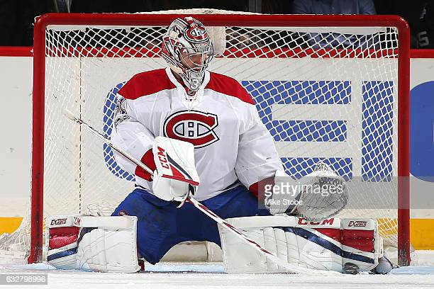 Carey Price of the Montreal Canadiens makes a save against the New York Islanders at the Barclays Center on January 26 2017 in Brooklyn borough of...
