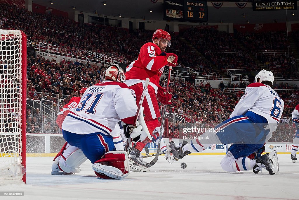 Carey Price #31 of the Montreal Canadiens makes a save as teammate Shea Weber #6 battles for the rebound with Riley Sheahan #15 of the Detroit Red Wings during an NHL game at Joe Louis Arena on January 16, 2017 in Detroit, Michigan. The Wings defeated the Canadiens 1-0.