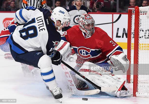 Carey Price of the Montreal Canadiens makes a save off the shot by Bryan Little of the Winnipeg Jets in the NHL game at the Bell Centre on November...
