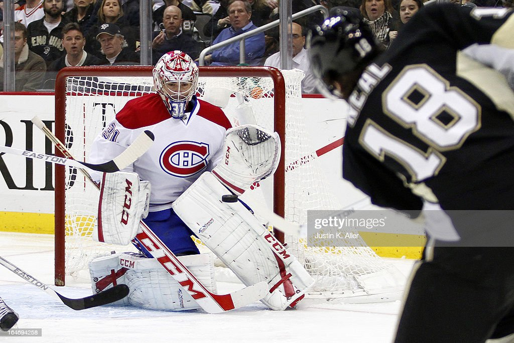 Carey Price #31 of the Montreal Canadiens makes a save on James Neal #18 of the Pittsburgh Penguins during the game at Consol Energy Center on March 26, 2013 in Pittsburgh, Pennsylvania. The Penguins defeated the Canadiens 1-0.