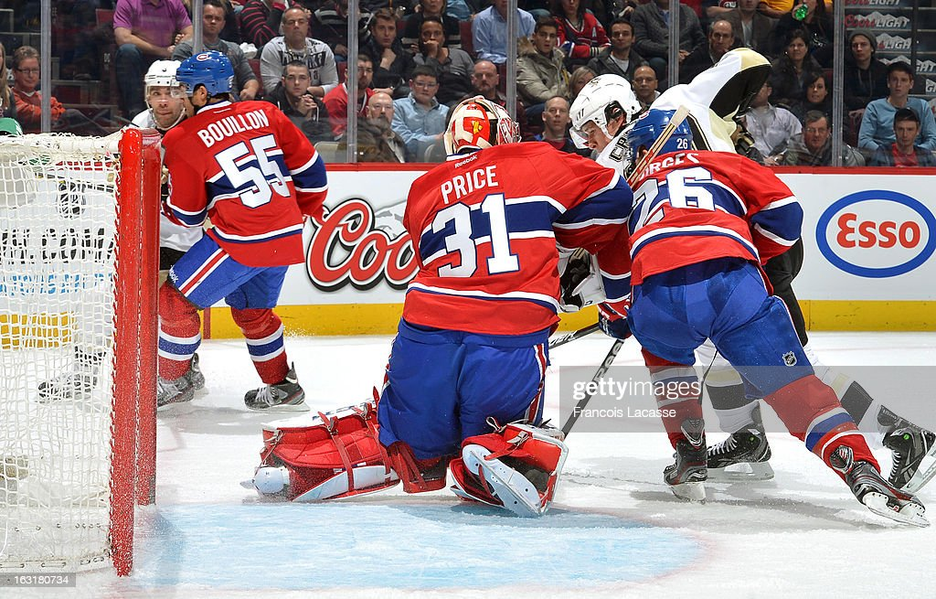 Carey Price #31 of the Montreal Canadiens makes a save on Sidney Crosby #87 of the Pittsburgh Penguins during the NHL game on March 2, 2013 at the Bell Centre in Montreal, Quebec, Canada.