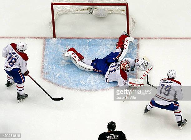 Carey Price of the Montreal Canadiens makes a save on Sidney Crosby of the Pittsburgh Penguins in the third period during the game at Consol Energy...