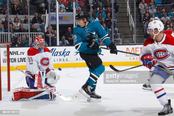 Carey Price of the Montreal Canadiens makes a save on the puck against Timo Meier of the San Jose Sharks at SAP Center on October 17 2017 in San Jose...