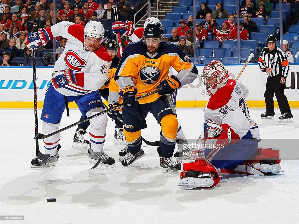 <a gi-track='captionPersonalityLinkClicked' href=/galleries/search?phrase=Carey+Price&family=editorial&specificpeople=2222083 ng-click='$event.stopPropagation()'>Carey Price</a> #31 of the Montreal Canadiens makes a third period save alongside teammate Douglas Murray #6 and <a gi-track='captionPersonalityLinkClicked' href=/galleries/search?phrase=Drew+Stafford&family=editorial&specificpeople=220617 ng-click='$event.stopPropagation()'>Drew Stafford</a> #21 of the Buffalo Sabres on November 27, 2013 at the First Niagara Center in Buffalo, New York. Montreal won, 3-1.