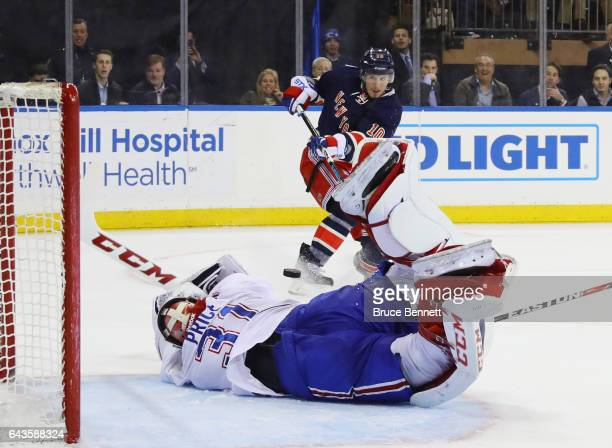 Carey Price of the Montreal Canadiens makes the diving save in the closing seconds of overtime against JT Miller of the New York Rangers at Madison...