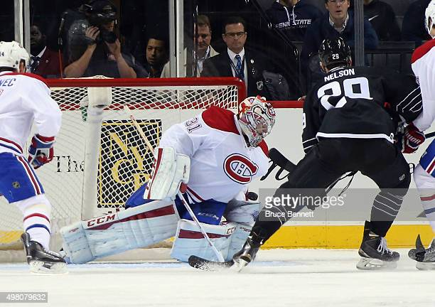 Carey Price of the Montreal Canadiens makes the first period save as Brock Nelson of the New York Islanders looks for the rebound at the Barclays...