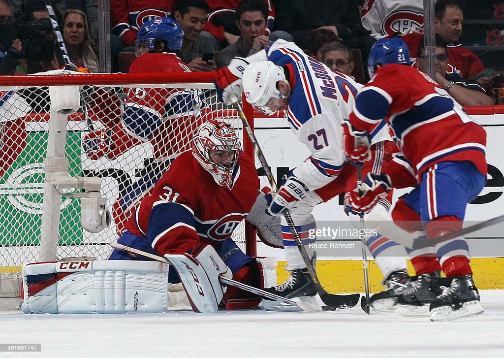 Carey Price #31 of the Montreal Canadiens makes the save on Ryan McDonagh #27 of the New York Rangers in Game One of the Eastern Conference Final during the 2014 Stanley Cup Playoffs at the Bell Centre on May 17, 2014 in Montreal, Canada. The Rangers defeated the Canadiens 7-2.