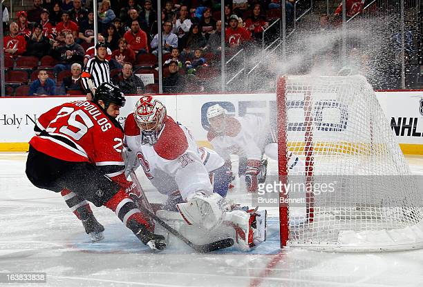 Carey Price of the Montreal Canadiens mkaes the second period save on Tom Kostopoulos of the New Jersey Devils at the Prudential Center on March 16...