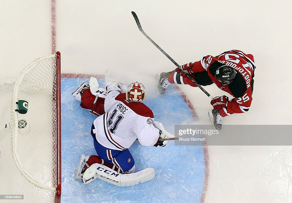 <a gi-track='captionPersonalityLinkClicked' href=/galleries/search?phrase=Carey+Price&family=editorial&specificpeople=2222083 ng-click='$event.stopPropagation()'>Carey Price</a> #31 of the Montreal Canadiens mkaes the second period save on <a gi-track='captionPersonalityLinkClicked' href=/galleries/search?phrase=Tom+Kostopoulos&family=editorial&specificpeople=209030 ng-click='$event.stopPropagation()'>Tom Kostopoulos</a> #25 of the New Jersey Devils at the Prudential Center on March 16, 2013 in Newark, New Jersey.
