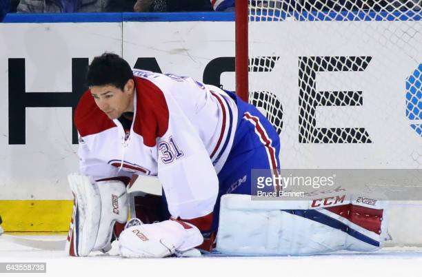 Carey Price of the Montreal Canadiens pauses as his mask is knocked off during the first period against the New York Rangers at Madison Square Garden...