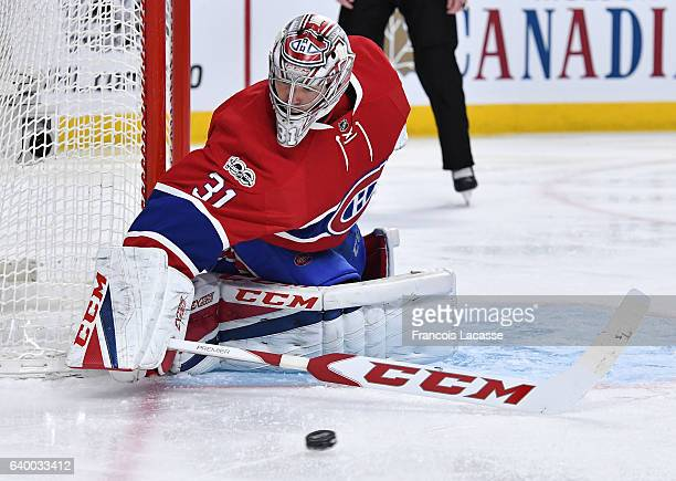 Carey Price of the Montreal Canadiens protects the goal against the Calgary Flames in the NHL game at the Bell Centre on January 24 2017 in Montreal...