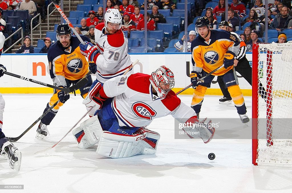 <a gi-track='captionPersonalityLinkClicked' href=/galleries/search?phrase=Carey+Price&family=editorial&specificpeople=2222083 ng-click='$event.stopPropagation()'>Carey Price</a> #31 of the Montreal Canadiens reaches to stop the puck before it crosses the goal line alongside teammate <a gi-track='captionPersonalityLinkClicked' href=/galleries/search?phrase=Andrei+Markov&family=editorial&specificpeople=204528 ng-click='$event.stopPropagation()'>Andrei Markov</a> #79 and <a gi-track='captionPersonalityLinkClicked' href=/galleries/search?phrase=Drew+Stafford&family=editorial&specificpeople=220617 ng-click='$event.stopPropagation()'>Drew Stafford</a> #21 and <a gi-track='captionPersonalityLinkClicked' href=/galleries/search?phrase=Cody+Hodgson&family=editorial&specificpeople=4151192 ng-click='$event.stopPropagation()'>Cody Hodgson</a> #19 of the Buffalo Sabres on November 27, 2013 at the First Niagara Center in Buffalo, New York. Montreal won, 3-1.
